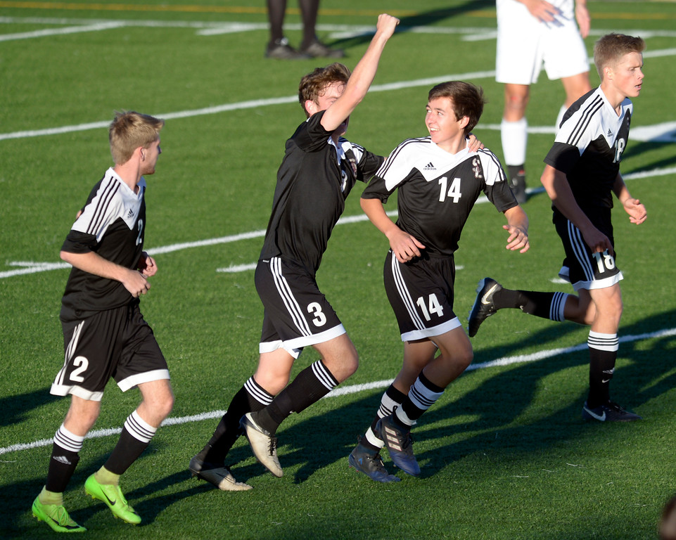 . Silver Creek\'s Jackson Pitts celebrates with teammate Dylan Weiss after Weiss scored a goal against Niwot in the first half Tuesday evening at Erie High School. Niwot won 2-1. To view more photos visit bocopreps.com. Lewis Geyer/Staff Photographer Oct. 10, 62017
