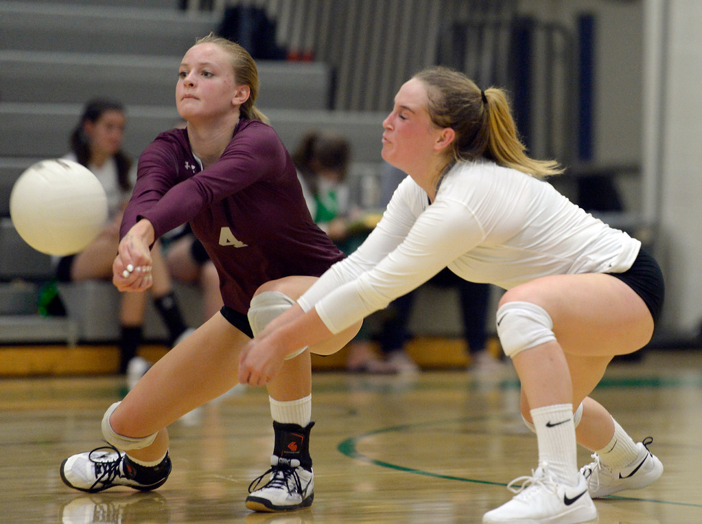 . NIWOT, CO - SEPTEMBER 11, 2018: Silver Creek\'s Megan Sotirof, left, and Megan Cunningham go after the ball during the second game against Niwot at Niwot High School Sep. 11. Niwot won in three games. (Photo by Lewis Geyer/Staff Photographer)