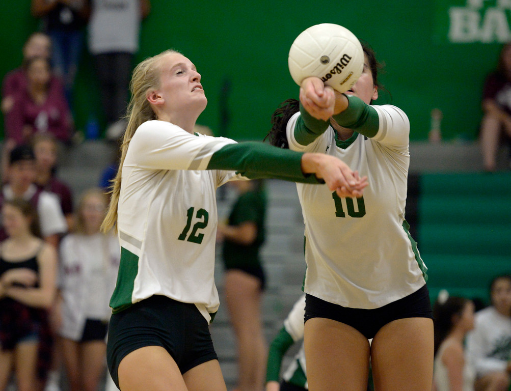. NIWOT, CO - SEPTEMBER 11, 2018: Niwot\'s Emma Falk, left, and Zoe Gonzales go after the ball during the second game against Silver Creek at Niwot High School Sep. 11. Niwot won in three games. (Photo by Lewis Geyer/Staff Photographer)