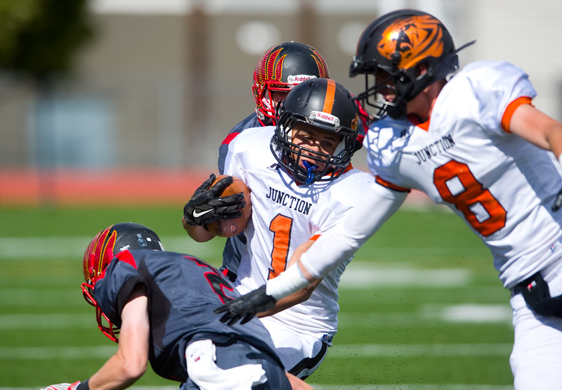 """Grand Junction's Christian Dennis is tackled by Skyline's Caleb Zietlow during the game at Montgomery Field at Longmont High School in Longmont on Saturday. <br /> More photos:  <a href=""""http://www.BoCoPreps.com"""">http://www.BoCoPreps.com</a><br /> (Autumn Parry/Staff Photographer)<br /> September 24, 2016"""