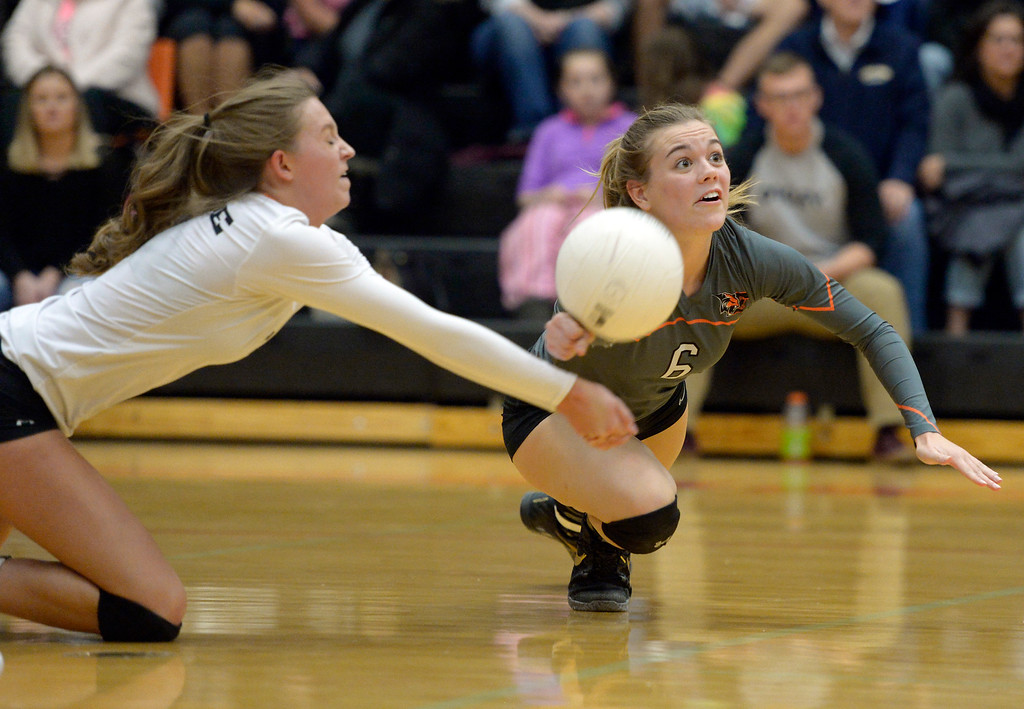 . Erie\'s Autymn Purcell, left, and Skylar Small nearly collide in the second set against Skyline Tuesday night at Erie High School. To view more photos visit bocopreps.com. Lewis Geyer/Staff Photographer Oct. 24, 62017