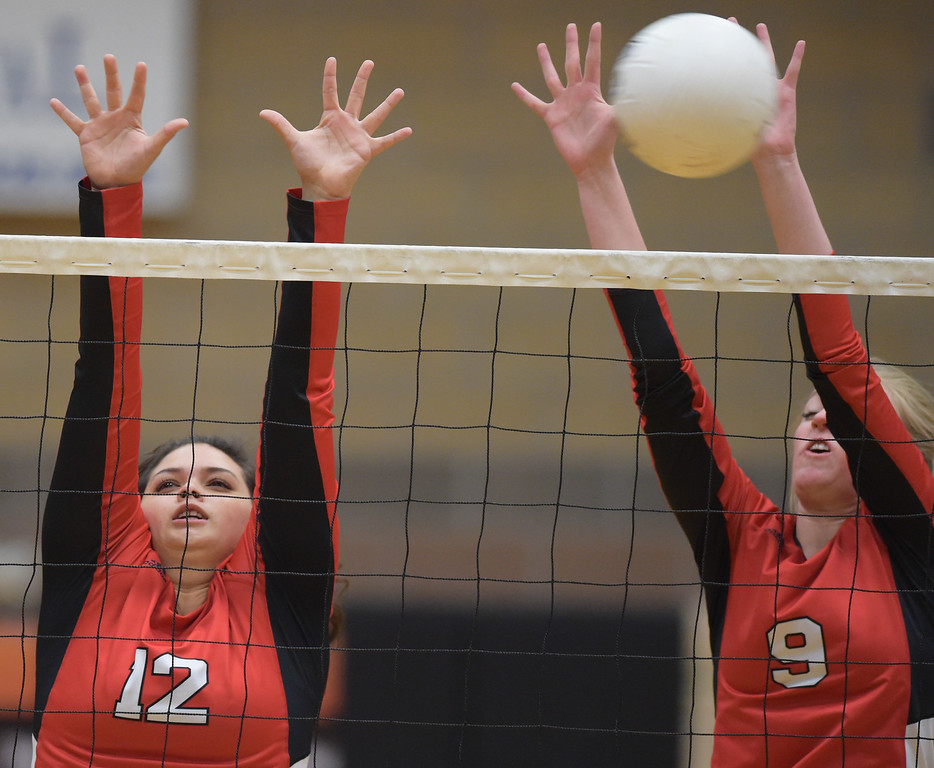 . Skyline\'s Hannah Bolitho and Jenny Dunder try to block in the second set against Erie Tuesday night at Erie High School. To view more photos visit bocopreps.com. Lewis Geyer/Staff Photographer Oct. 24, 62017
