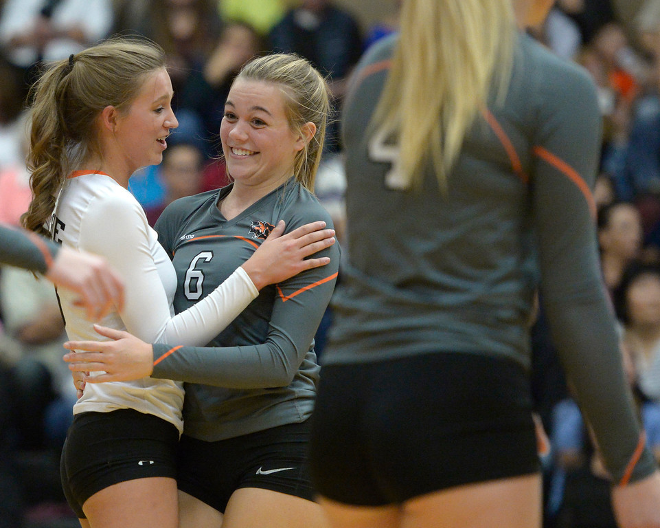 . Erie\'s Autymn Purcell, left, and Skylar Small check on each other after nearly colliding in the second set against Skyline Tuesday night at Erie High School. To view more photos visit bocopreps.com. Lewis Geyer/Staff Photographer Oct. 24, 62017