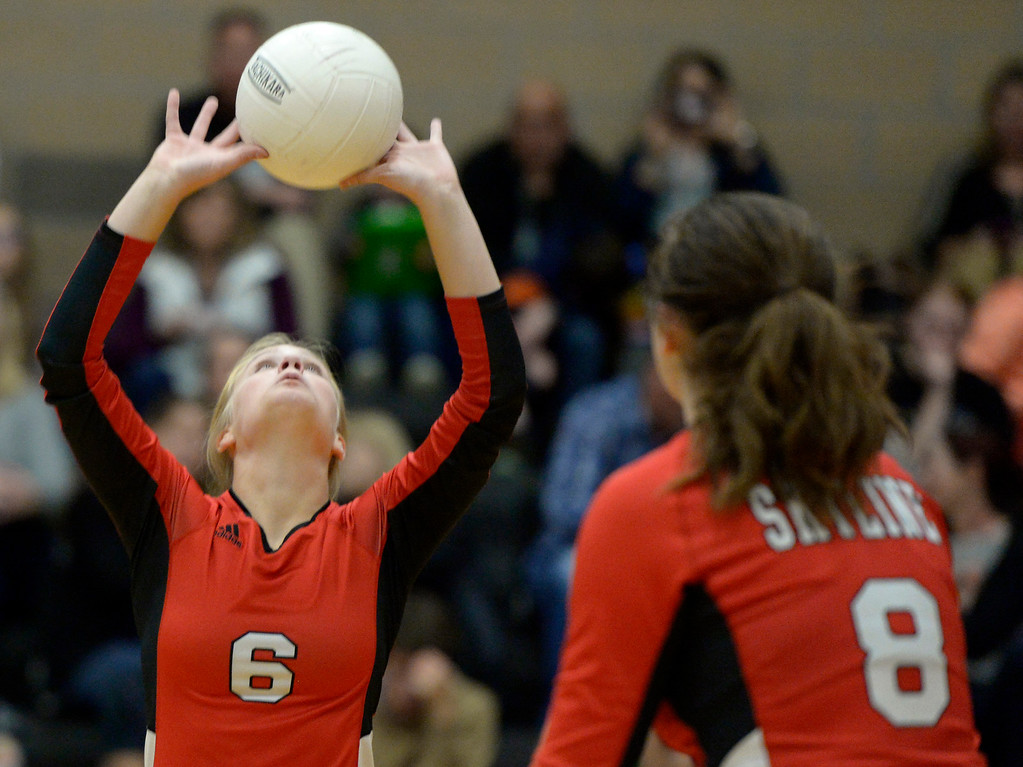 . Skyline\'s Abby Stoops sets the ball in the second set against Erie Tuesday night at Erie High School. To view more photos visit bocopreps.com. Lewis Geyer/Staff Photographer Oct. 24, 62017