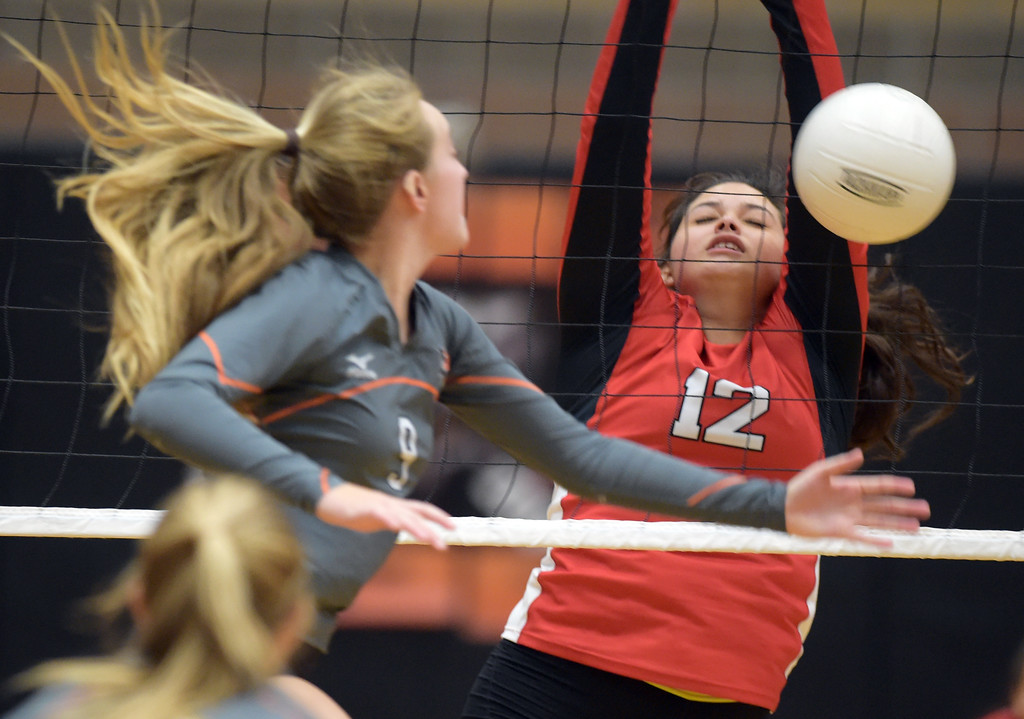 . Erie\'s Sydney Crites sends the ball into the net in front of Skyline\'s Hannah Bolitho during the second set Tuesday night at Erie High School. To view more photos visit bocopreps.com. Lewis Geyer/Staff Photographer Oct. 24, 62017