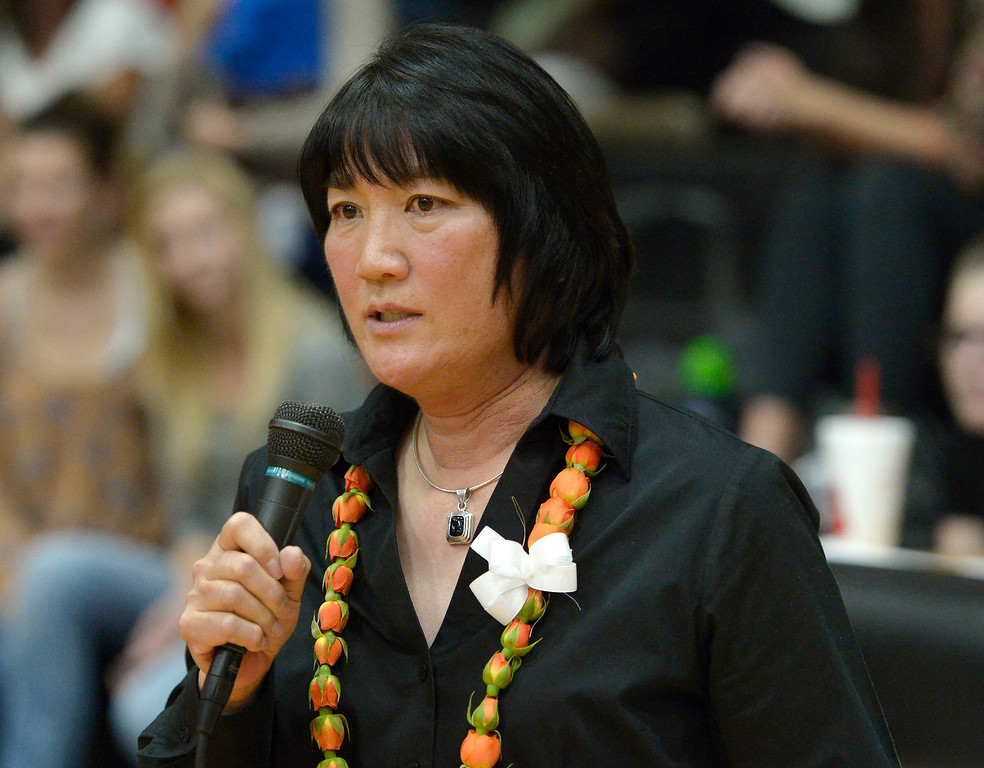 . Retiring Erie coach Nancy Tanaka addresses the crowd during a ceremony between sets Tuesday night at Erie High School. To view more photos visit bocopreps.com. Lewis Geyer/Staff Photographer Oct. 24, 62017