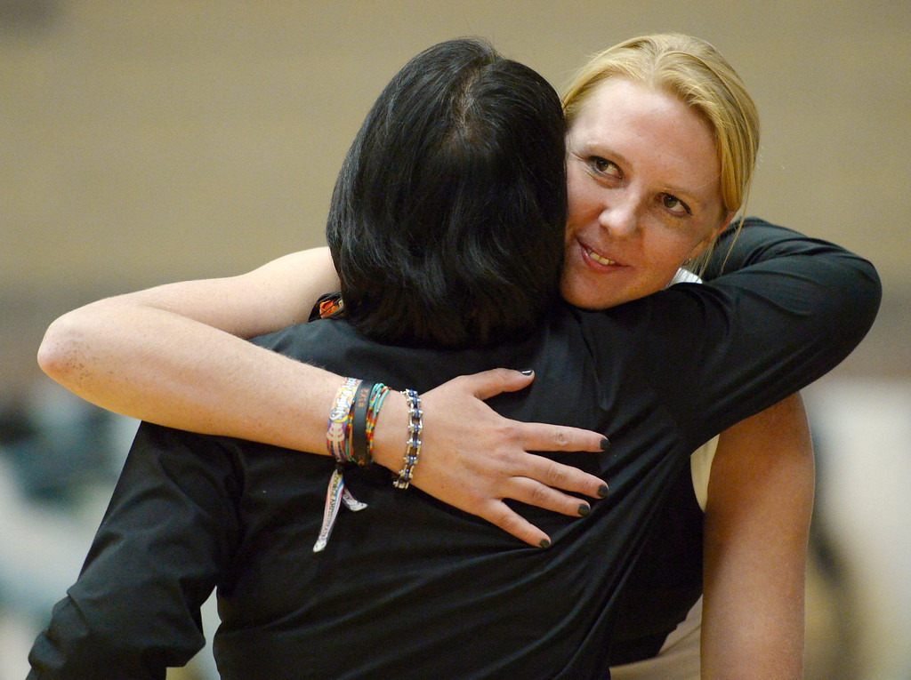 . Erie volleyball coach Molly Creek embraces retiring coach Nancy Tanaka during a ceremony Tuesday night at Erie High School. To view more photos visit bocopreps.com. Lewis Geyer/Staff Photographer Oct. 24, 62017