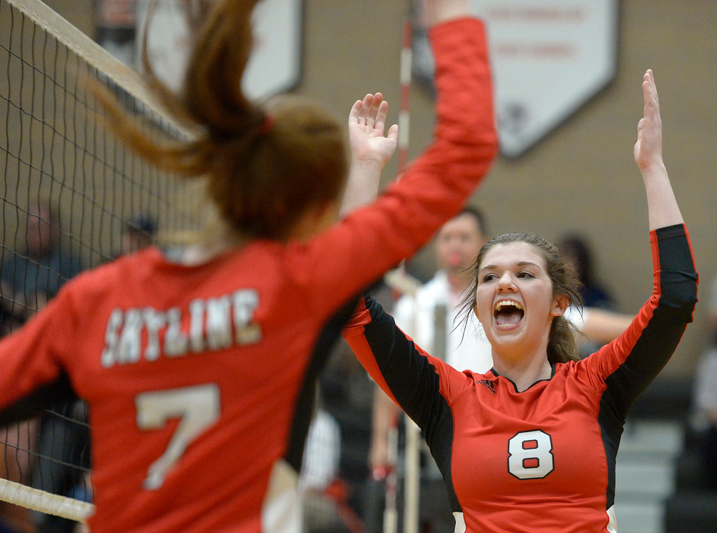. Skyline\'s Julia Webb celebrates a point scored against Erie in the second set Tuesday night at Erie High School. To view more photos visit bocopreps.com. Lewis Geyer/Staff Photographer Oct. 24, 62017