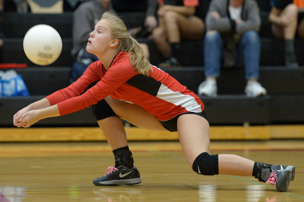 . Skyline\'s Abby Stoops goes low to make contact with the ball in the second set against Erie Tuesday night at Erie High School. To view more photos visit bocopreps.com. Lewis Geyer/Staff Photographer Oct. 24, 62017