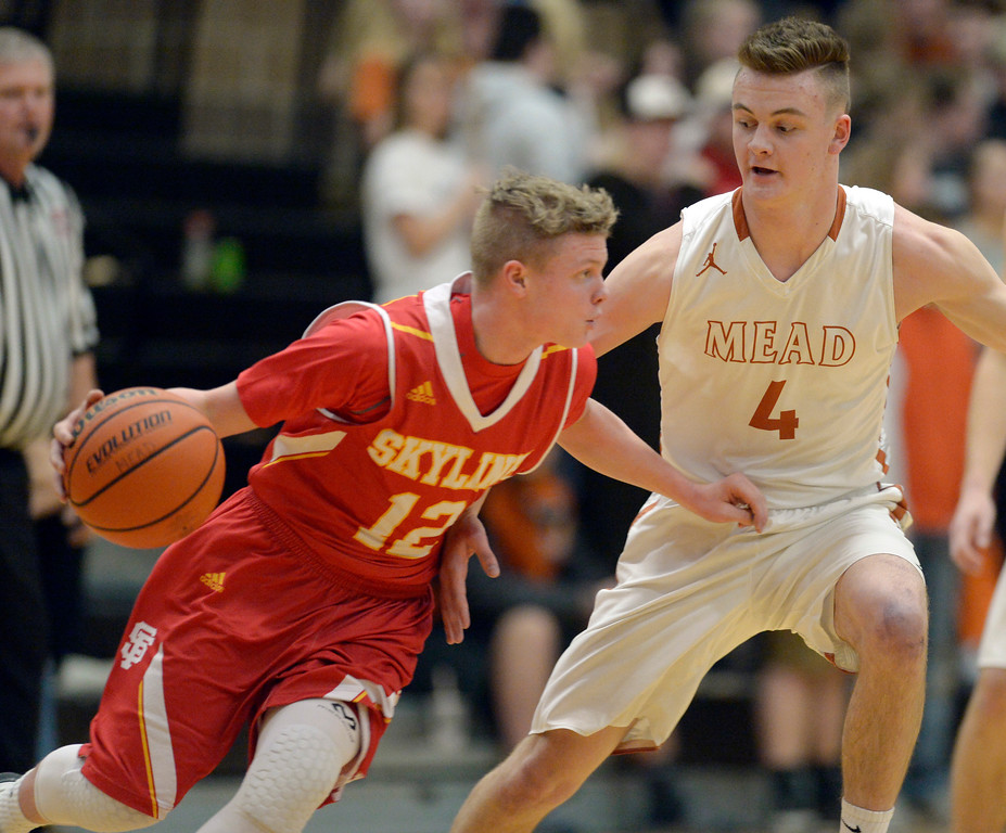 . Skyline\'s Hayden Robison dribbles around Mead\'s David Wilhelm in the first quarter Tuesday night at Mead High School. To view more photos visit bocopreps.com. Lewis Geyer/Staff Photographer Feb. 06, 2018