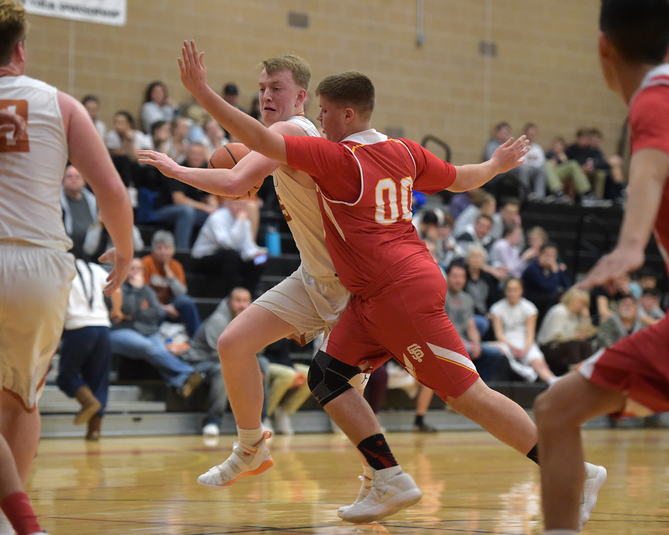 . Skyline\'s Connor Smith fouls Mead\'s Jax Wilke in the first quarter Tuesday night at Mead High School. To view more photos visit bocopreps.com. Lewis Geyer/Staff Photographer Feb. 06, 2018