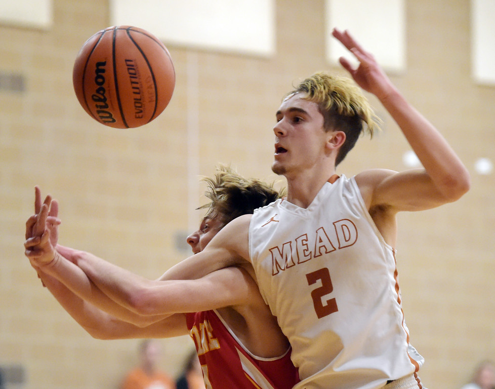 . Skyline\'s Brayden Blick and Mead\'s Nick Jacobs get tangled up in the first quarter Tuesday night at Mead High School. To view more photos visit bocopreps.com. Lewis Geyer/Staff Photographer Feb. 06, 2018