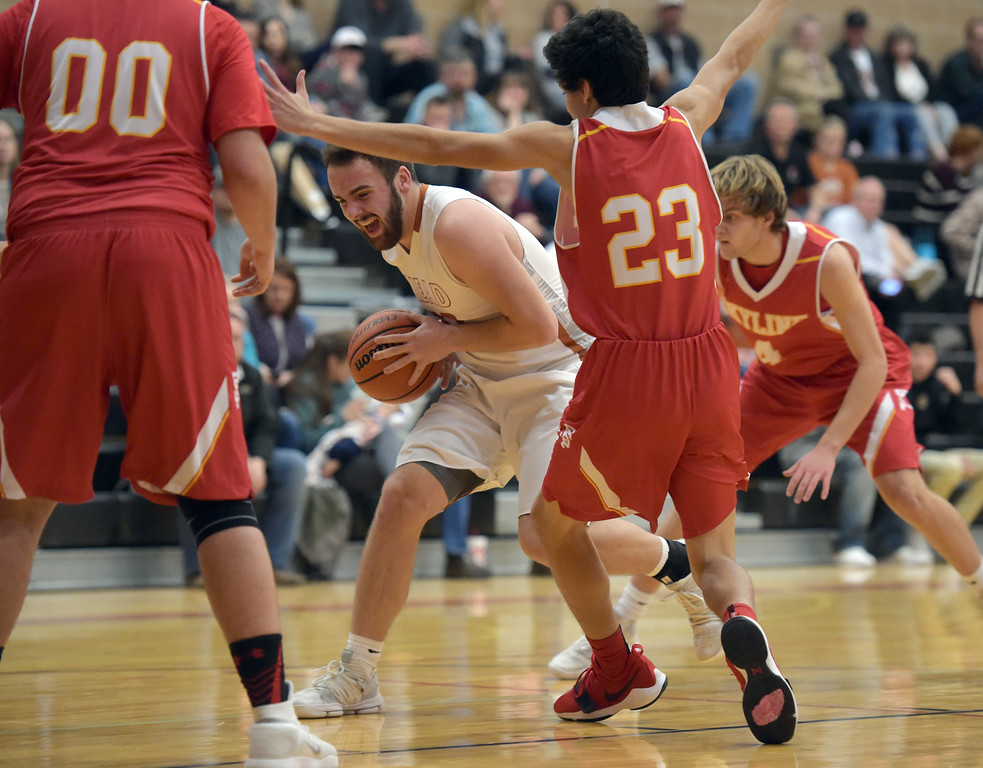 . Mead\'s KJ Jacobs drives past Skyline\'s Esteban Morado in the second quarter Tuesday night at Mead High School. To view more photos visit bocopreps.com. Lewis Geyer/Staff Photographer Feb. 06, 2018