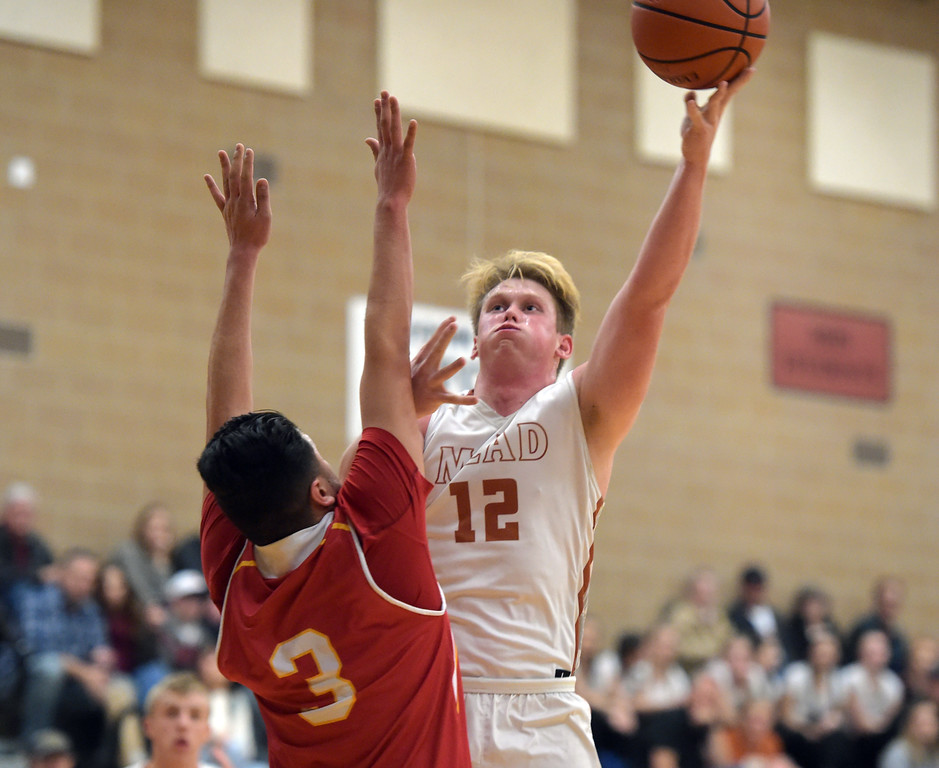 . Mead\'s Derek Edwards shoots over Skyline\'s Camilo Martinez in the first quarter Tuesday night at Mead High School. To view more photos visit bocopreps.com. Lewis Geyer/Staff Photographer Feb. 06, 2018