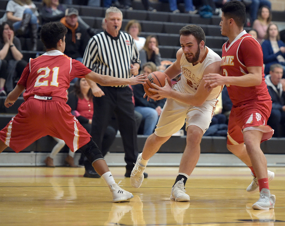 . Mead\'s KJ Jacobs drives between Skyline\'s Chris Roy, left, and Camilo Martinez in the second quarter Tuesday night at Mead High School. To view more photos visit bocopreps.com. Lewis Geyer/Staff Photographer Feb. 06, 2018