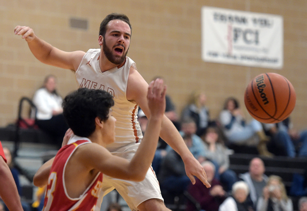 . Mead\'s KJ Jacobs pases the ball against Skyline in the second quarter Tuesday night at Mead High School. To view more photos visit bocopreps.com. Lewis Geyer/Staff Photographer Feb. 06, 2018