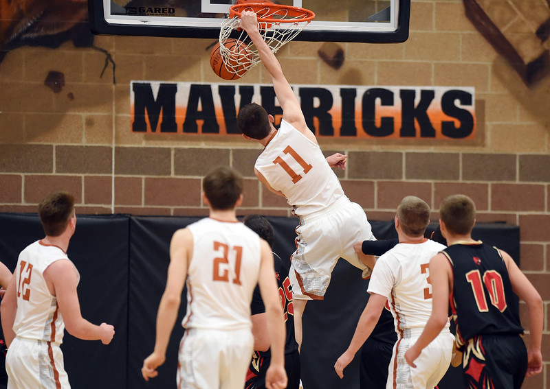 Mead's Walker Korell dunks the ball against Skyline in the first quarter Friday night at Mead High School. <br /> Lewis Geyer/Staff Photographer<br /> Feb. 12, 2016