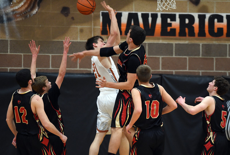 Mead's Michael Rice has his shot blocked by Skyline's Matt Dietz in the first quarter Friday night at Mead High School. <br /> Lewis Geyer/Staff Photographer<br /> Feb. 12, 2016