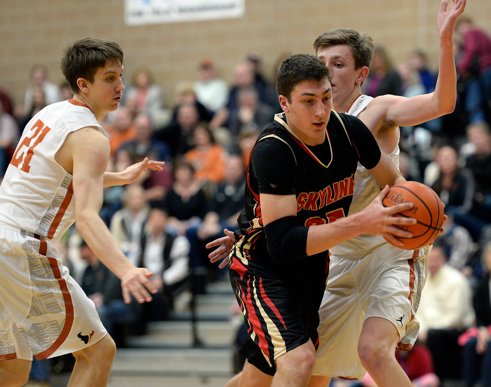 Skyline's Matt Dietz drives between Mead's Michael Rice, left, and Alex Sandstrom in the first quarter Friday night at Mead High School. <br /> Lewis Geyer/Staff Photographer<br /> Feb. 12, 2016
