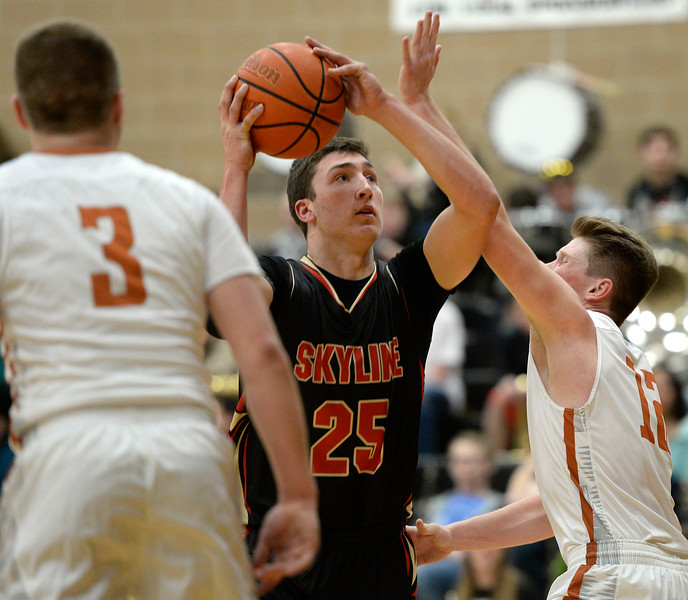 Skyline's Matt Dietz looks to the basket over Mead's Derek Edwards in the first quarter Friday night at Mead High School. <br /> Lewis Geyer/Staff Photographer<br /> Feb. 12, 2016