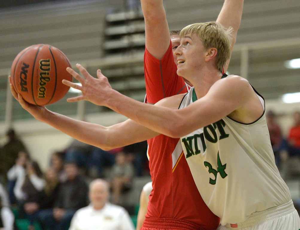 . NIWOT, CO - DECEMBER 11: Niwot\'s Dominik Luthens shoots around Skyline\'s Austin Robison in the first quarter at Niwot High School December 11, 2018. To view more photos visit bocopreps.com. Skyline won 58-39. To view more photos visit bocopreps.com. (Photo by Lewis Geyer/Staff Photographer)