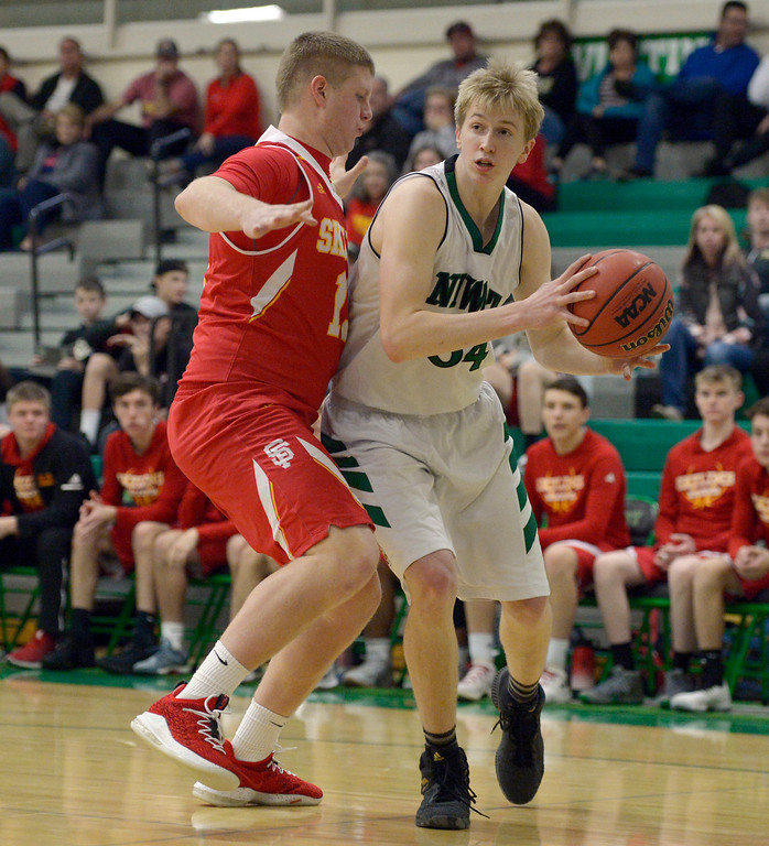 . NIWOT, CO - DECEMBER 11: Skyline\'s Austin Robison covers Niwot\'s Dominik Luthens in the first quarter at Niwot High School December 11, 2018. To view more photos visit bocopreps.com. Skyline won 58-39. To view more photos visit bocopreps.com. (Photo by Lewis Geyer/Staff Photographer)