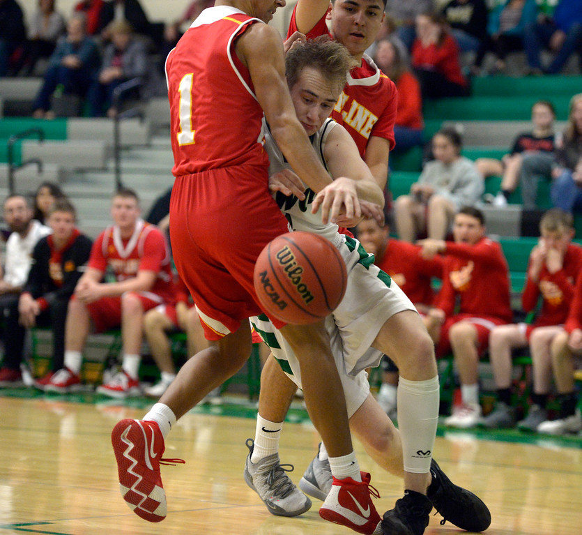 . NIWOT, CO - DECEMBER 11: Niwot\'s Thomas Bounds runs into Skyline\'s Chris Roy as Adrian Compian covers from behind in the second quarter at Niwot High School December 11, 2018.  To view more photos visit bocopreps.com. Skyline won 58-39. To view more photos visit bocopreps.com. (Photo by Lewis Geyer/Staff Photographer)