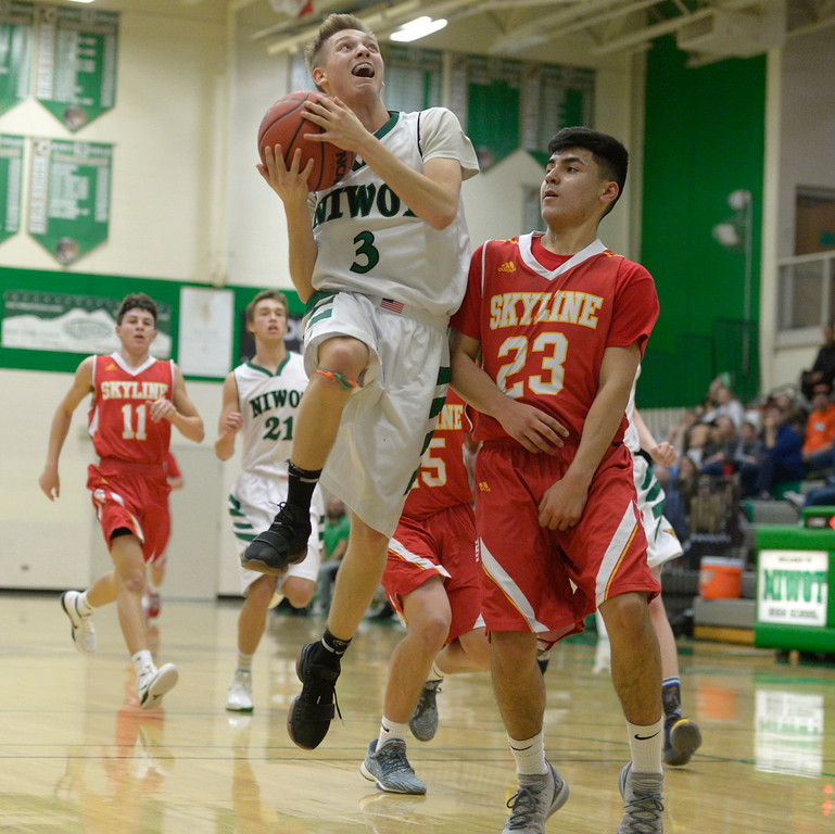 . NIWOT, CO - DECEMBER 11: Niwot\'s Alex Erikson is covered by Skyline\'s Adrian Compian in the second quarter at Niwot High School December 11, 2018. Skyline won 58-39. To view more photos visit bocopreps.com. (Photo by Lewis Geyer/Staff Photographer)