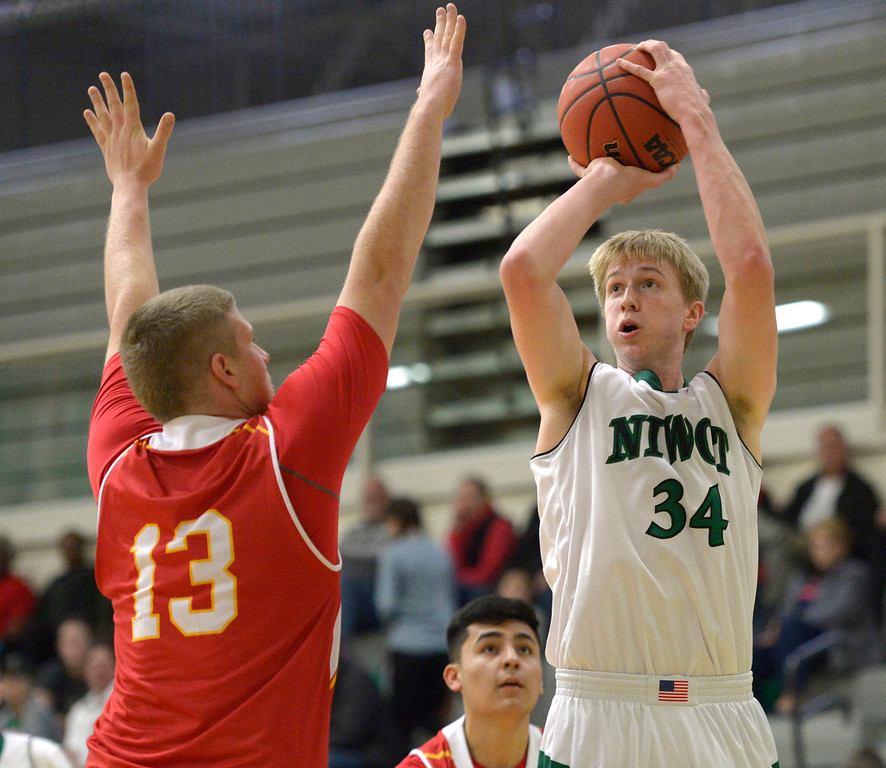 . NIWOT, CO - DECEMBER 11: Niwot\'s Dominik Luthens shoots over Skyline\'s Austin Robison in the first quarter at Niwot High School December 11, 2018. To view more photos visit bocopreps.com. Skyline won 58-39. To view more photos visit bocopreps.com. (Photo by Lewis Geyer/Staff Photographer)