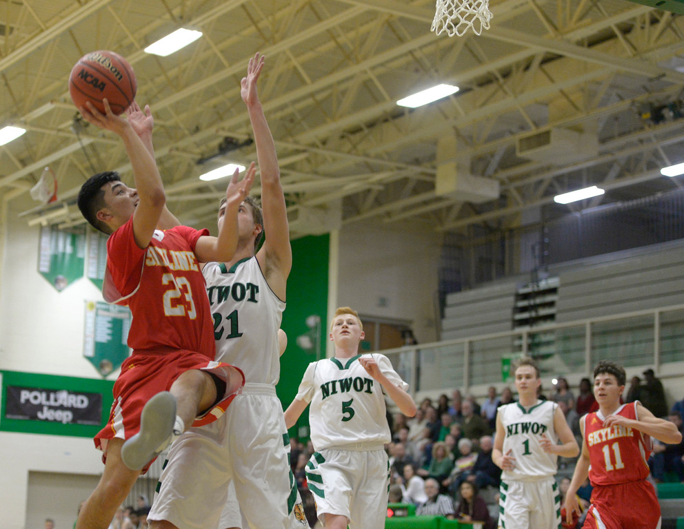 . NIWOT, CO - DECEMBER 11: Skyline\'s Adrian Compian takes a shot against Niwot\'s Austin Rathburn in the fourth quarter at Niwot High School December 11, 2018. Skyline won 58-39. To view more photos visit bocopreps.com.(Photo by Lewis Geyer/Staff Photographer)