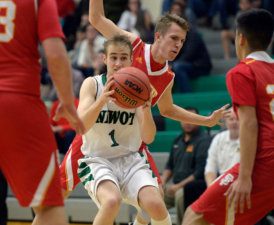 . NIWOT, CO - DECEMBER 11: Niwot\'s Thomas Bounds is fouled by Skyline\'s Braeden Elwood in the first quarter at Niwot High School December 11, 2018. To view more photos visit bocopreps.com. Skyline won 58-39. To view more photos visit bocopreps.com. (Photo by Lewis Geyer/Staff Photographer)