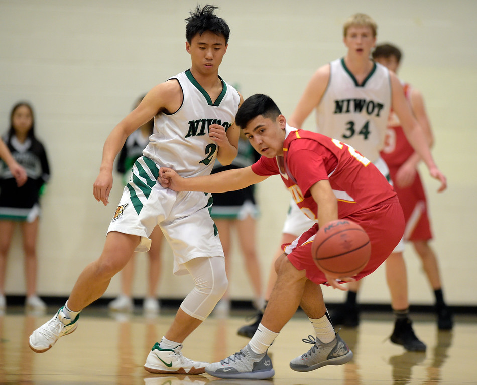. NIWOT, CO - DECEMBER 11: Niwot\'s Marcus Chong knocks the ball away from Skyline\'s Adrian Compian in the first quarter at Niwot High School December 11, 2018. To view more photos visit bocopreps.com. Skyline won 58-39. To view more photos visit bocopreps.com. (Photo by Lewis Geyer/Staff Photographer)