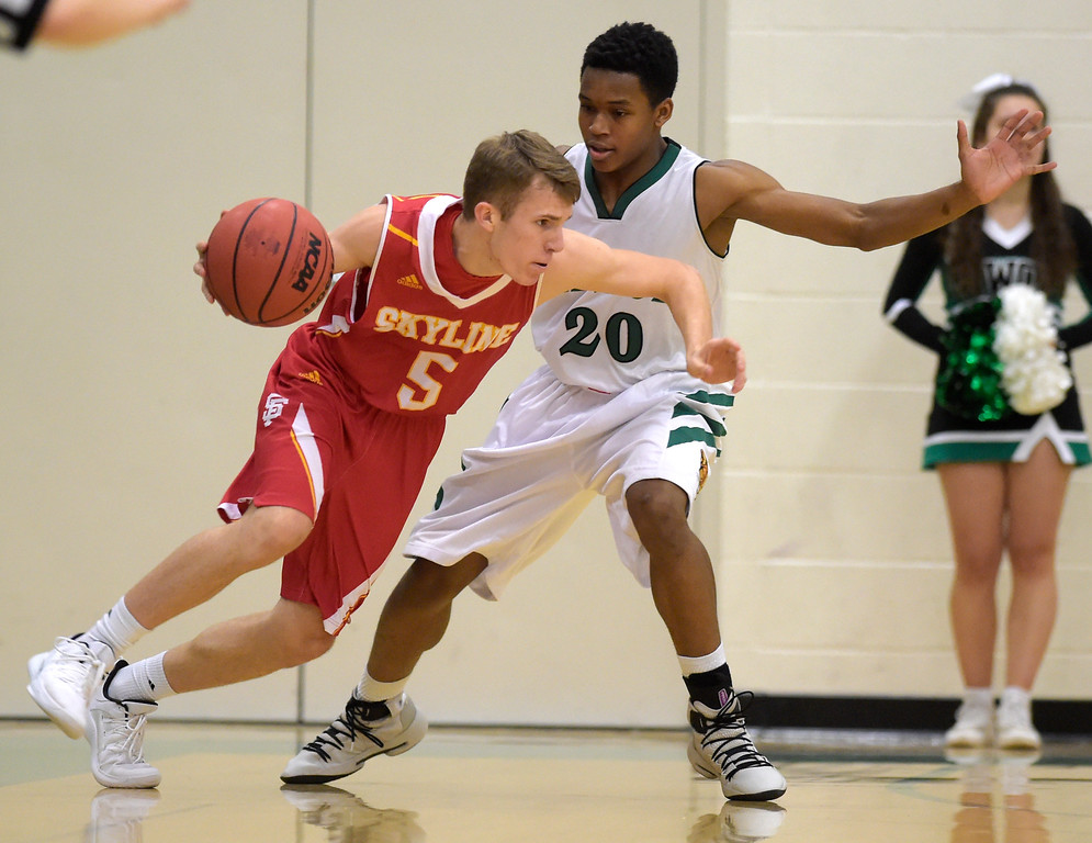 . NIWOT, CO - DECEMBER 11: Skyline\'s Braden Elwood drives around Niwot\'s Kyle Reeves in the first quarter at Niwot High School December 11, 2018. To view more photos visit bocopreps.com. Skyline won 58-39. To view more photos visit bocopreps.com. (Photo by Lewis Geyer/Staff Photographer)