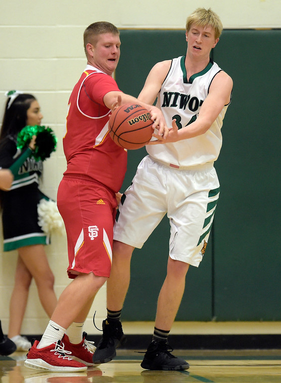 . NIWOT, CO - DECEMBER 11: Skyline\'s Austin Robison knocks the ball away from Niwot\'s Dominik Luthens in the first quarter at Niwot High School December 11, 2018. To view more photos visit bocopreps.com. Skyline won 58-39. To view more photos visit bocopreps.com. (Photo by Lewis Geyer/Staff Photographer)