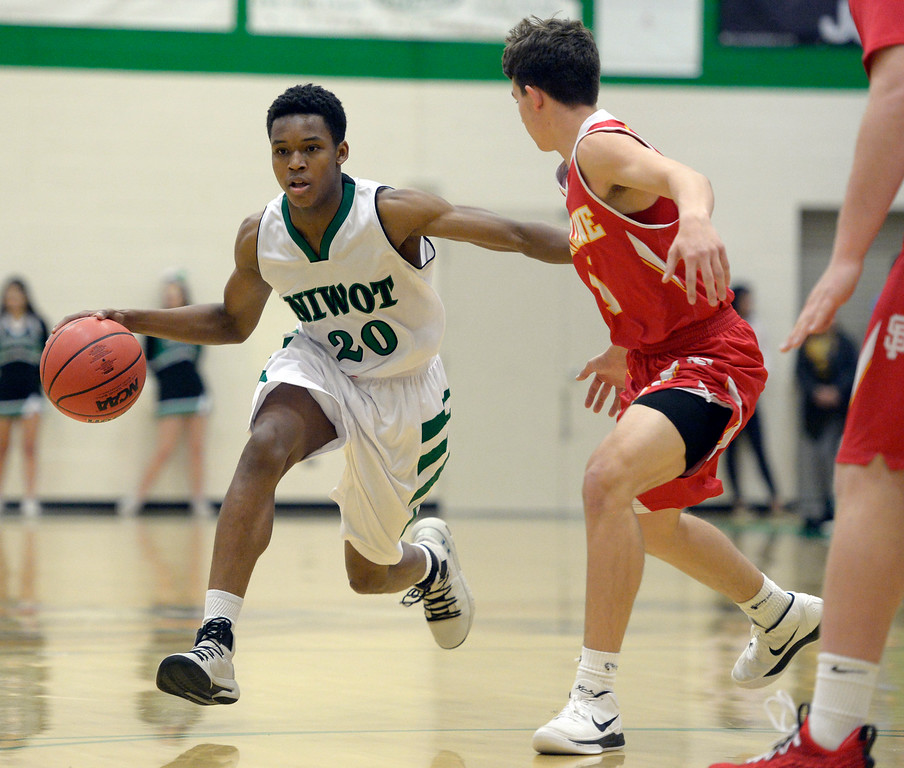 . NIWOT, CO - DECEMBER 11: Niwot\'s Kyle Reeves moves the ball at the top of the key against Skyline in the first quarter at Niwot High School December 11, 2018. To view more photos visit bocopreps.com. Skyline won 58-39. To view more photos visit bocopreps.com. (Photo by Lewis Geyer/Staff Photographer)