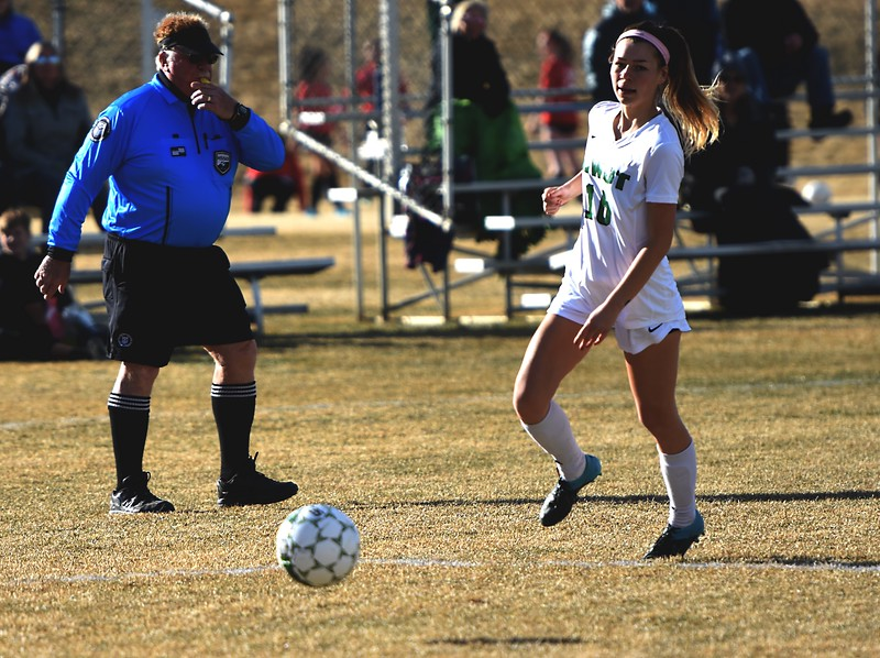 Niwot's Sage Marten chases down a long pass against Skyline on Tuesday, March 20, in Niwot.
