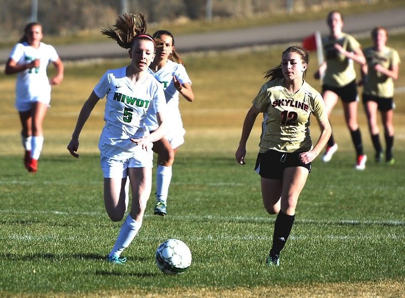 Niwot's Kiera Flanagan and Skyline's Brooke Parkinson race to a loose ball on Tuesday, March 20, in Niwot.