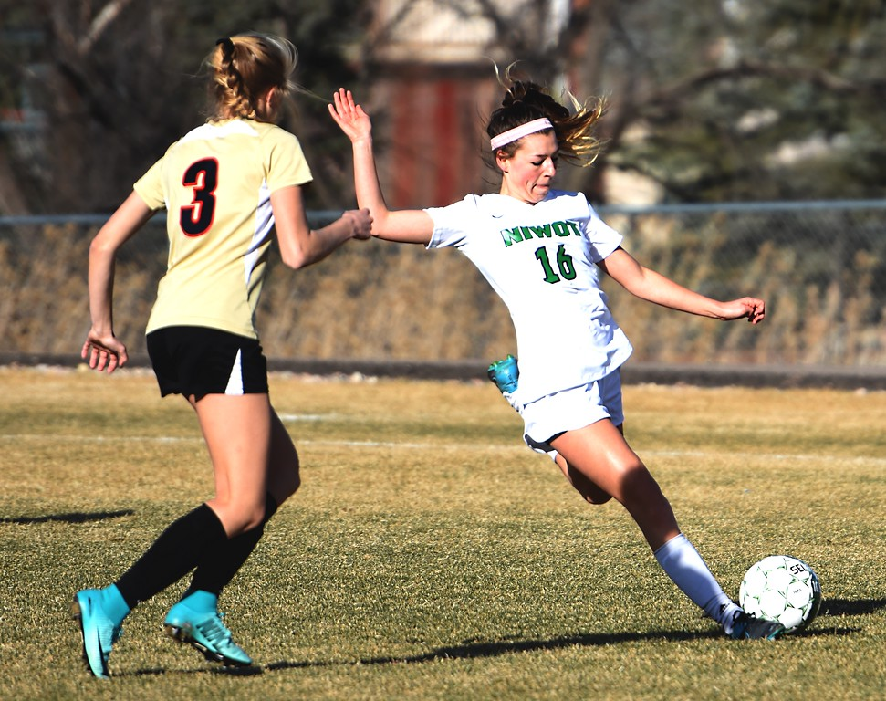 Niwot's Sage Marten crosses the ball into the box against Skyline on Tuesday, March 20, in Niwot.