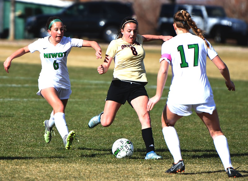 Skyline's Brie Musser shoots during the Falcons' game against Niwot on Tuesday, March 20, in Niwot.