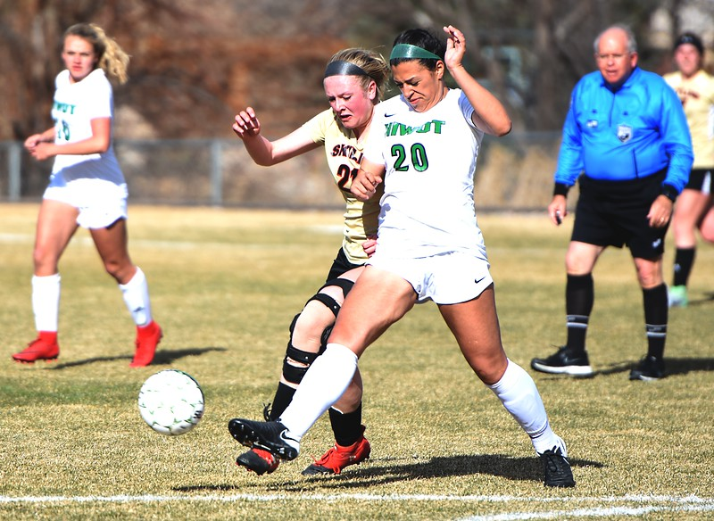 Niwot's Nazary Ramirez battles for the ball with Skyline's Lindrey Schendel on Tuesday, March 20, in Niwot.