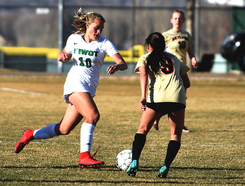 Niwot's Maddie Borncamp attempts to get by Skyline's Serena Fortes on Tuesday, March 20, in Niwot.