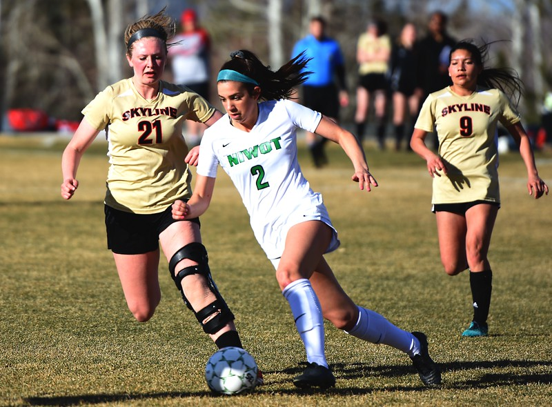 Niwot's Anna McCarthy dribbles through the Skyline defense on Tuesday, March 20, in Niwot.