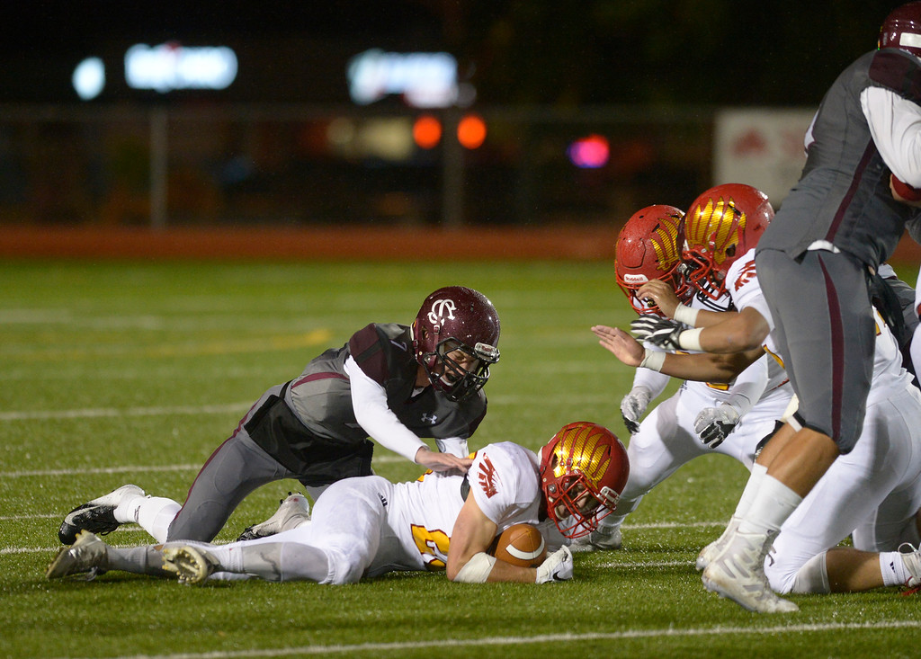 . LONGMONT, CO - OCTOBER 5: Skyline\'s Jack Wathen falls on a Silver Creek fumble in the first quarter at Everly-Montgomery Field Oct. 05, 2018. (Photo by Lewis Geyer/Staff Photographer)