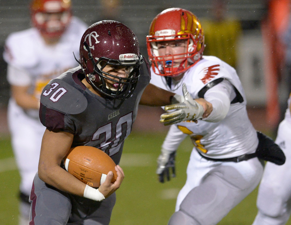 . LONGMONT, CO - OCTOBER 5: Silver Creek\'s Matthew Murphy gets by Skyline\'s Nathan McGregor in the first quarter at Everly-Montgomery Field Oct. 05, 2018. (Photo by Lewis Geyer/Staff Photographer)