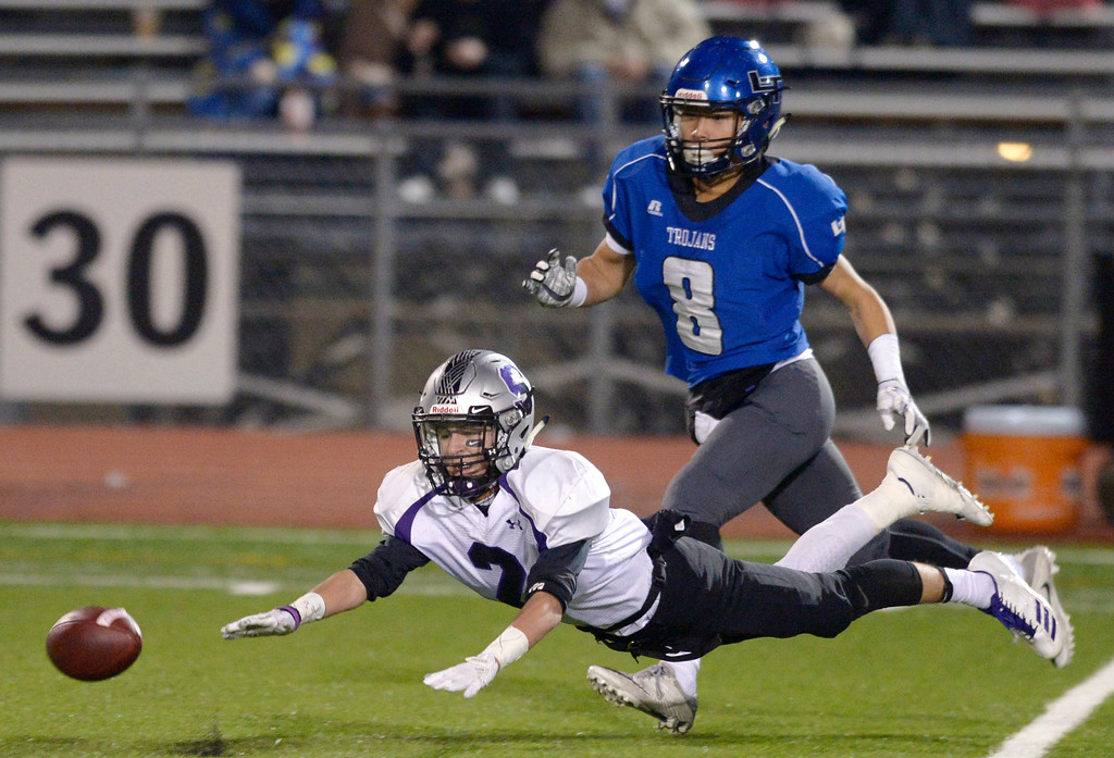 . Skyview\'s Corey Musch can\'t reach the ball as Longmont\'s Anthony Rodriguez covers in the first quarter Friday night at Everly-Montgomery Field. To view more photos visit bocopreps.com. Lewis Geyer/Staff Photographer Nov. 10, 2017