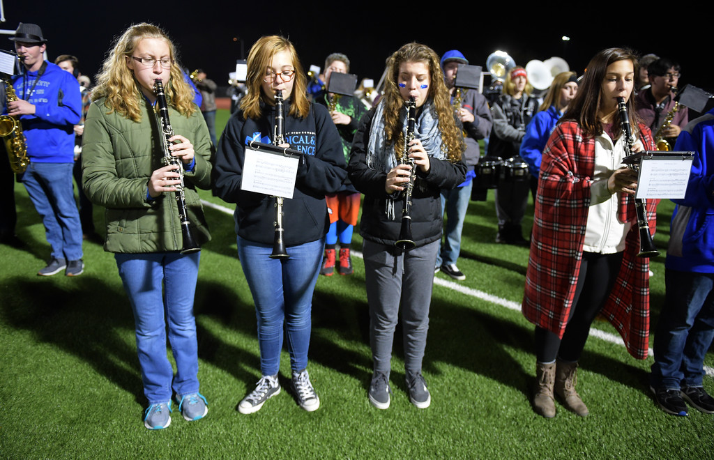 . The Longmont High Marching Band performs the National Anthem before their team\'s playoff game against Skyview Friday night at Everly-Montgomery Field. To view more photos visit bocopreps.com. Lewis Geyer/Staff Photographer Nov. 10, 2017