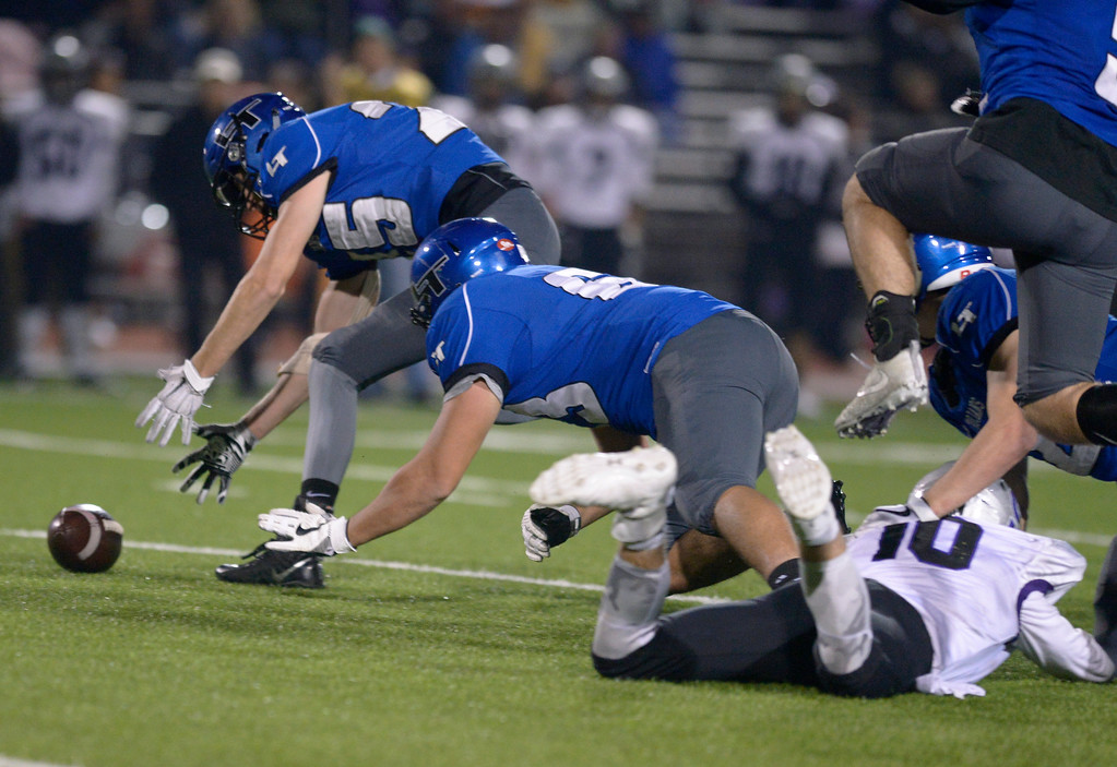 . Longmont\'s Mathew Sprecher picks up a Skyview fumble which he carried to the end zone for a touchdown in the second quarter Friday night at Everly-Montgomery Field. To view more photos visit bocopreps.com. Lewis Geyer/Staff Photographer Nov. 10, 2017