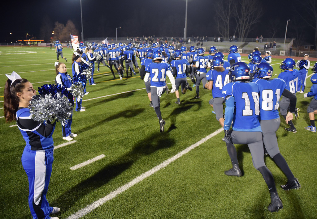 . The Longmont High football team takes the field for their playoff game against Skyview Friday night at Everly-Montgomery Field. To view more photos visit bocopreps.com. Lewis Geyer/Staff Photographer Nov. 10, 2017
