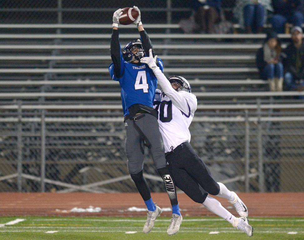 . Longmont\'s Nick Paone intercepts a pass intended for Skyview\'s Anthony Gonzalez in the first quarter Friday night at Everly-Montgomery Field. To view more photos visit bocopreps.com. Lewis Geyer/Staff Photographer Nov. 10, 2017
