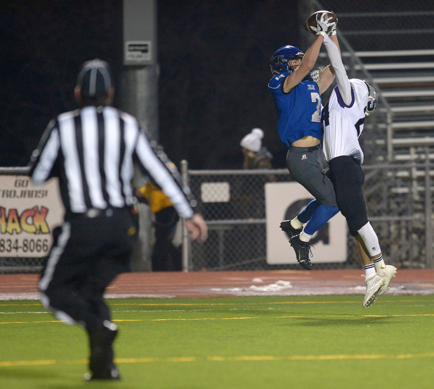 . Longmont\'s Danny Nichols makes a touchdown reception against Skyview\'s Oswaldo Padilla in the second quarter Friday night at Everly-Montgomery Field. To view more photos visit bocopreps.com. Lewis Geyer/Staff Photographer Nov. 10, 2017